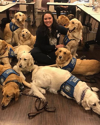 Comfort dogs brought smiles to everyone they met at Sunrise.