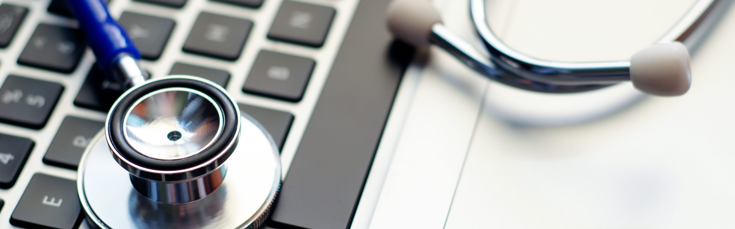 Stethoscope on Computer Laptop Keyboard