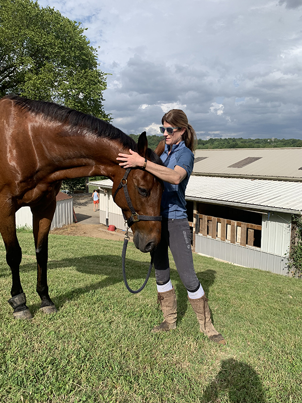 Sydney Hester, MD, with her horse, Hughey