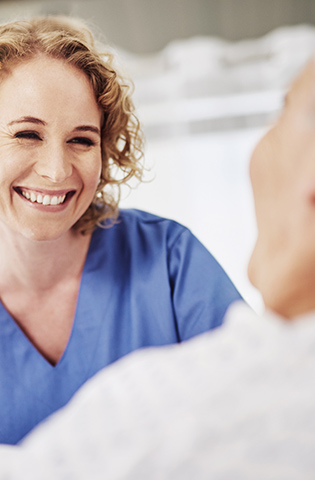 Shot of a female carer talking to her recovering male patient