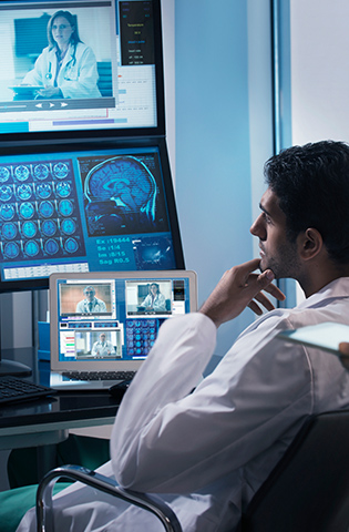Doctor examining x-rays in video conference
