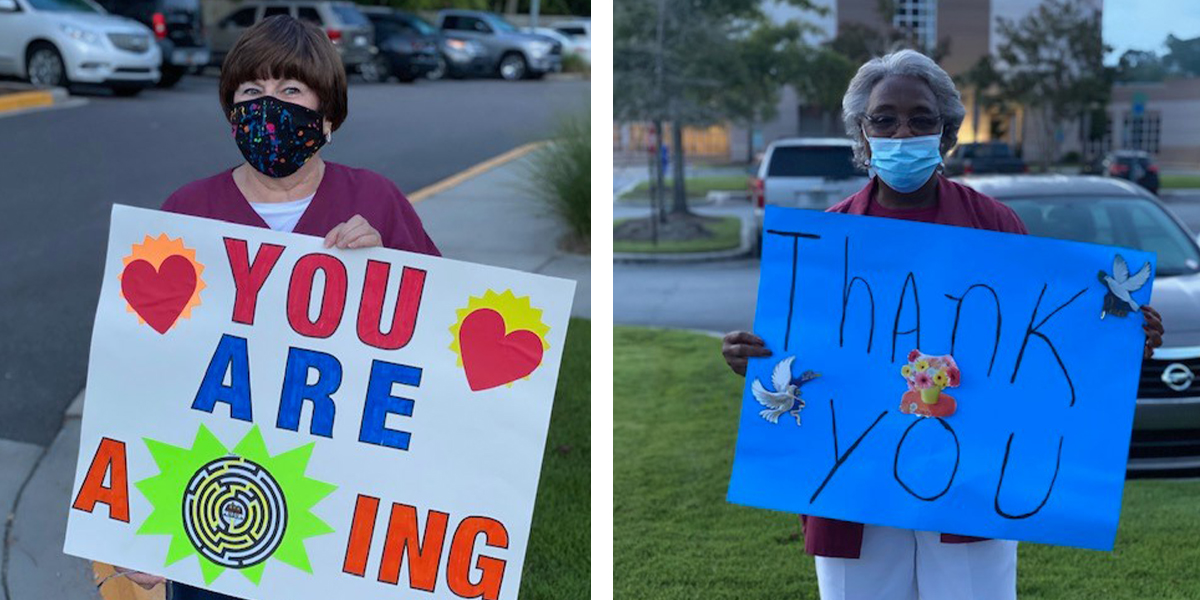 Supporters holding signs for healthcare workers