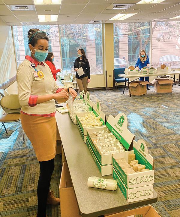 volunteers prepare hygiene kits