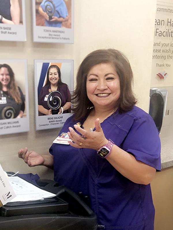 Irene Salazar environmental services awards wall